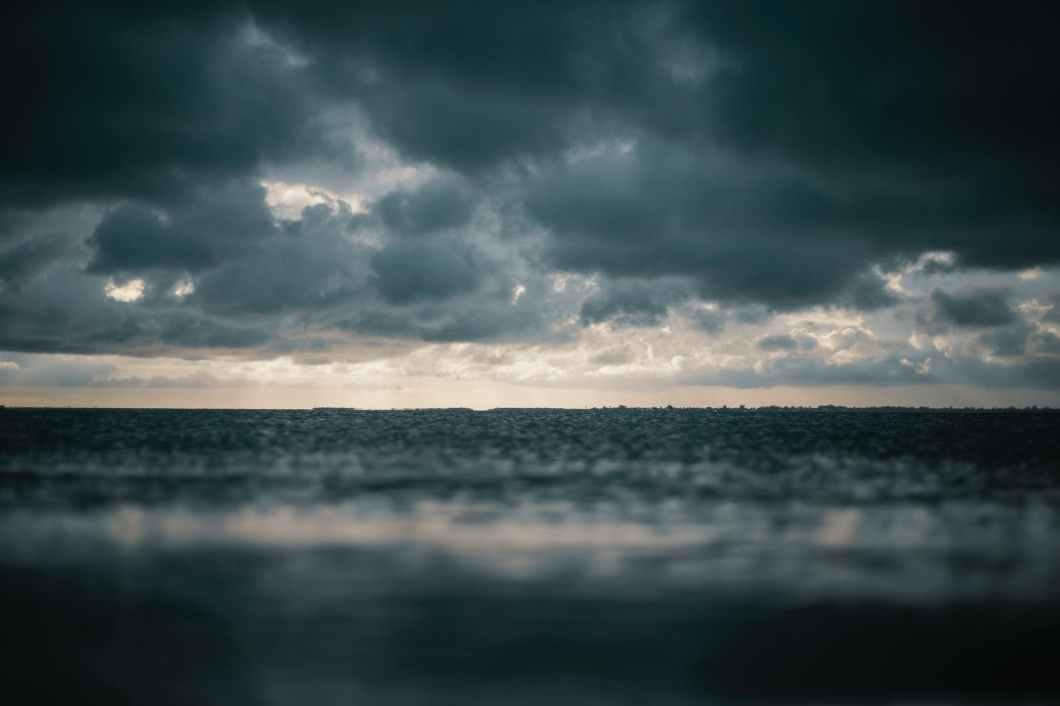 beach clouds dark dark clouds