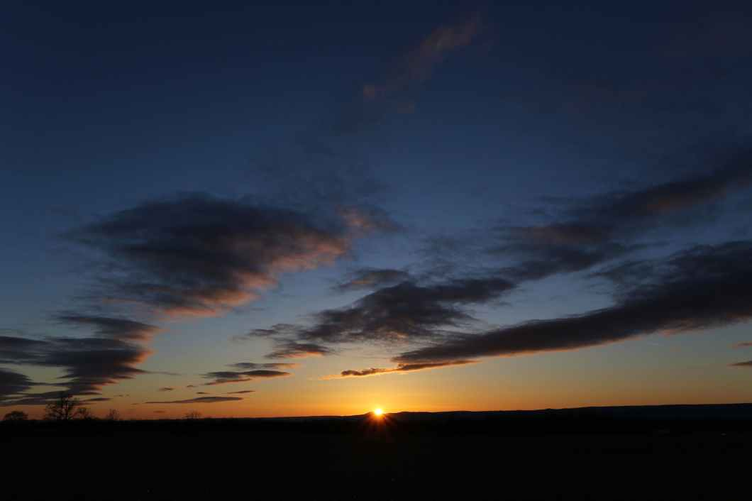 backlit beach clouds dawn